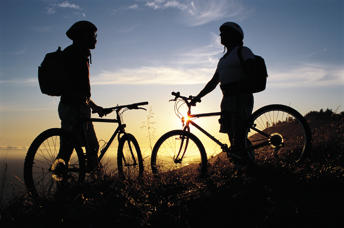 Silhouette of two bicylists in the sunset