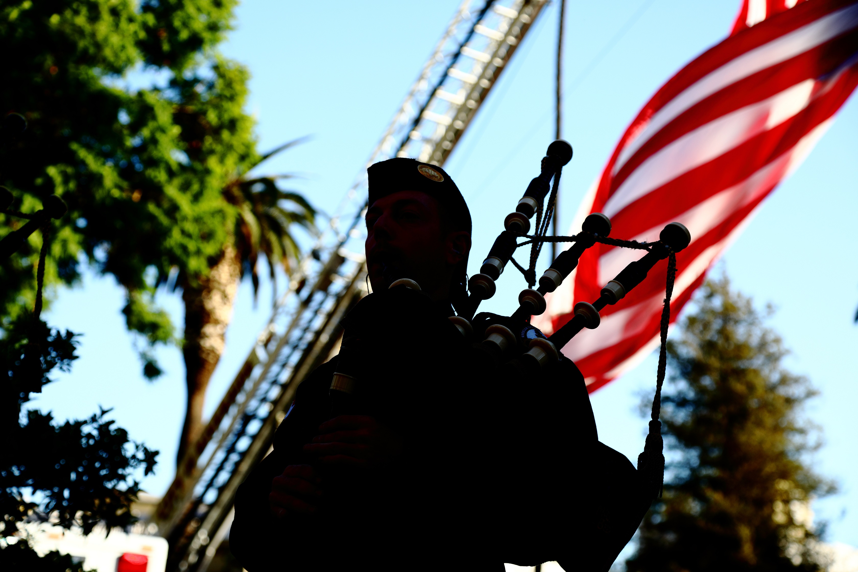Bagpiper and US flag